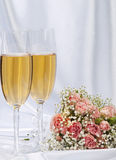 Two glasses with champagne and bouquet  roses Royalty Free Stock Photos