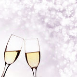Two glasses of champagne on brillante background Stock Images