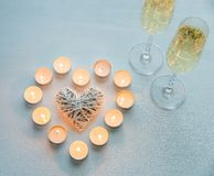 Two glasses of champagne with candles Royalty Free Stock Photography