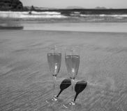 Two glasses of champagne or cava sparkling wine served on the white sandy tropical beach, luxury resort with sea view, romantic v royalty free stock photos