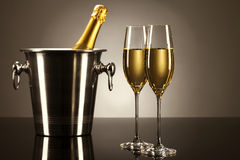 Two glasses of champagne with a champagne bucket Royalty Free Stock Photo