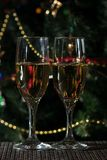 Two glasses of champagne on christmas background royalty free stock images