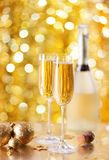 Two glasses of champagne with a Christmas decor in the background. very shallow depth of field, focus on near glass.  stock images