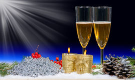 Two glasses of champagne with Christmas decor and candles Royalty Free Stock Image