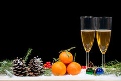 Two glasses of champagne with christmas decor Royalty Free Stock Images