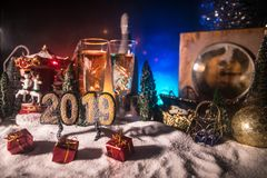 Two glasses of champagne with Christmas decoration. Traditional winter holiday alcohol drink in snow with creative New Year stock image