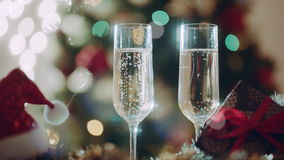 Two glasses with champagne on Christmas Eve stock video footage