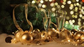 Two glasses of champagne with christmas present and christmas balls stock video