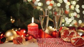 Two glasses of champagne with christmas present and christmas balls. Two glasses of champagne with christmas present and christmas  balls stock footage