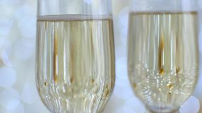 Two glasses with champagne. Christmas romantic mood. Bubbles in the glass.  stock video footage