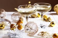 Two glasses of champagne with Christmas tree background.Christmas and New Year celebration with champagne. royalty free stock photos