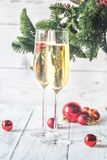 Two glasses of champagne with Christmas tree stock photography
