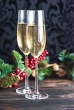 Gasses of champagne with Christmas tree. Two glasses of champagne with Christmas tree branch Royalty Free Stock Photo