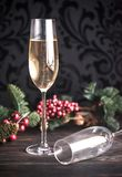 Gasses of champagne with Christmas tree. Two glasses of champagne with Christmas tree branch Royalty Free Stock Image