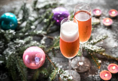 Two glasses of champagne with Christmas tree branch Royalty Free Stock Image