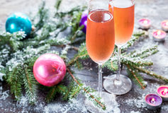 Two glasses of champagne with Christmas tree branch Stock Photos