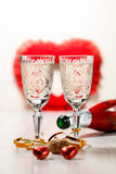 Two glasses of champagne, cork, sweets and champagne bottle Stock Photo