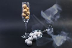 Two glasses of champagne on dark background with smoke royalty free stock images