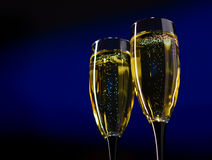 Two Glasses of Champagne on Dark Blue Background Royalty Free Stock Photography