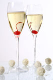 Two glasses with champagne and desert cherry Stock Photography