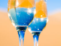 Two glasses of champagne on a desert Stock Image