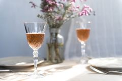 Two glasses of champagne on a dining table stock photos
