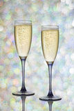 Two glasses of champagne on festive background.  Royalty Free Stock Photo