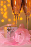 Two glasses of champagne and a gift. With a holiday decoration in the St. Valentine's Day Stock Image
