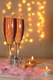 Two glasses of champagne and a gift. With a holiday decoration in the St. Valentine's Day Stock Images