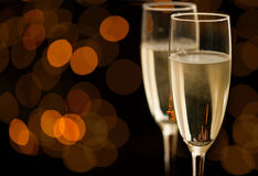 Two glasses of champagne with golden bokeh Stock Photography