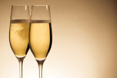 Two glasses of champagne with golden bubbles Royalty Free Stock Images