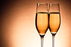 Two glasses of champagne with golden bubbles and space for text Royalty Free Stock Photo