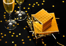 Two glasses of champagne with golden gift boxes Stock Photo