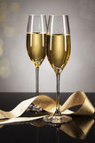Two glasses of champagne with a golden ribbon Stock Photo