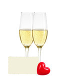 Two glasses of champagne, greeting card and red heart isolated Stock Photography