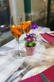 Two glasses of champagne from the house. On a table in a Italian restaurant royalty free stock images