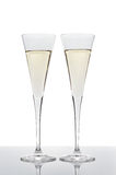 Two glasses of champagne isolated on white. Royalty Free Stock Image