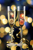 Two glasses of champagne with lights in the background. Stock Photography