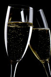 Two glasses champagne macro. Object on black - champagne glasses close up Royalty Free Stock Image