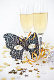 Two glasses of champagne and a mask Stock Photos