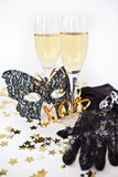Two glasses of champagne and a mask Stock Photo