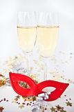 Two glasses of champagne and a mask Royalty Free Stock Photography