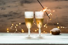 Glasses of champagne on background of new year lights stock photo