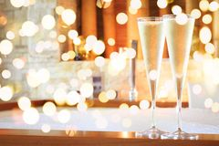 Two glasses of champagne near jacuzzi. Valentines background. Romance concept. Bold festive bokeh stock images