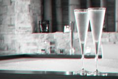 Two glasses of champagne near jacuzzi. Valentines background. Romance concept. Glitch effect. Two glasses of champagne near jacuzzi. Valentines background royalty free stock photography