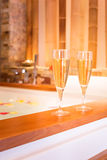 Two glasses of champagne near jacuzzi Royalty Free Stock Photography
