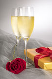 Two Glasses of Champagne with One Single Red Rose and Box of Gourmet Chocolates #1 Stock Photos