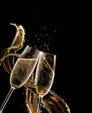 Two glasses of champagne over black background royalty free stock photography