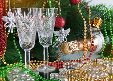 Two glasses of champagne over color new years background. Two glasses of champagne over color Christmas background stock photography