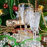 Two glasses of champagne over color new years background. Two glasses of champagne over color Christmas background royalty free stock image